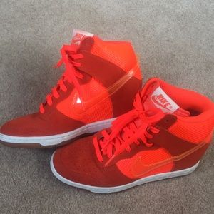 Bright orange Nike shoes with clear swoosh